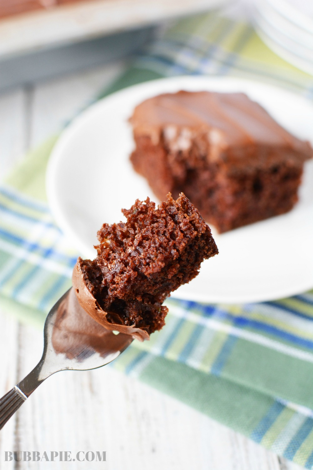 Easy chocolate Zucchini Cake being served on a fork.