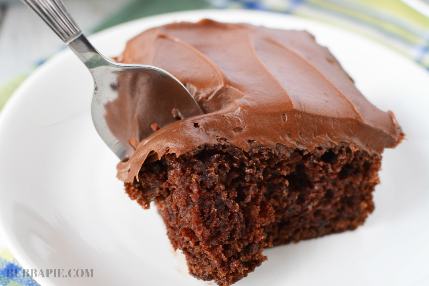 Chocolate Zucchini Cake Recipe is made with shredded vegetables and greek yogurt for a very moist cake.