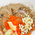 mix in pineapple, grated carrot and white chocolate