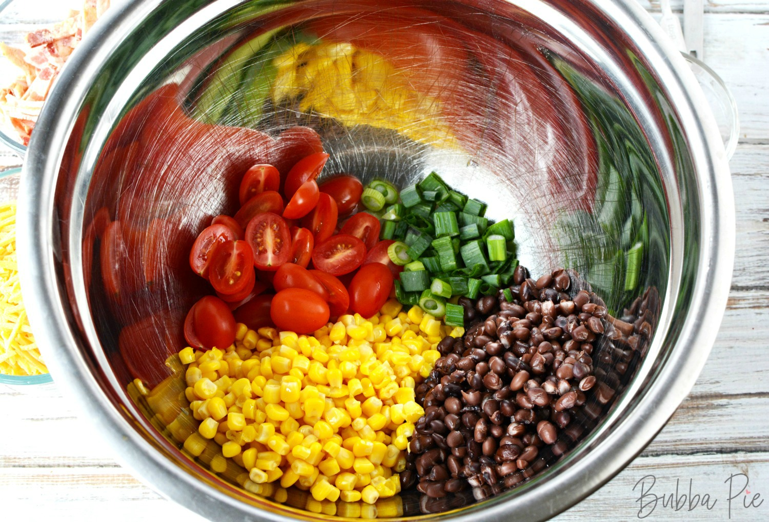 recipe for cowboy pasta salad has corn, black beans, tomatoes, cilantro,