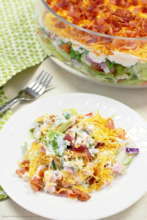 7 layer salad is a delicious recipe to bring to potlucks and pitchins.