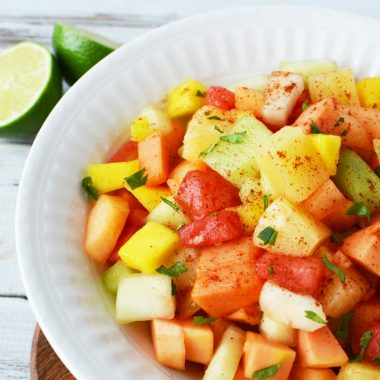 Mexican Fruit Salad is made with tropical fruit and a chili lime sauce