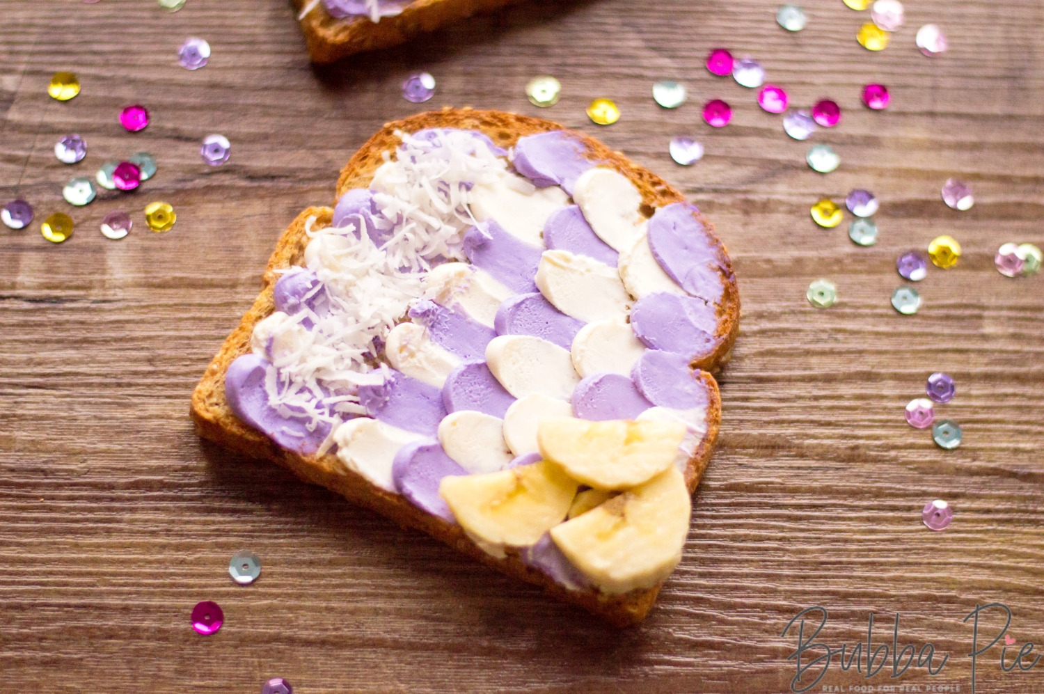 Mermaid Toast sitting on a table with decorative sprinkles and confetti