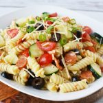 Rotini Pasta Salad Recipe sitting on a plate with a napkin