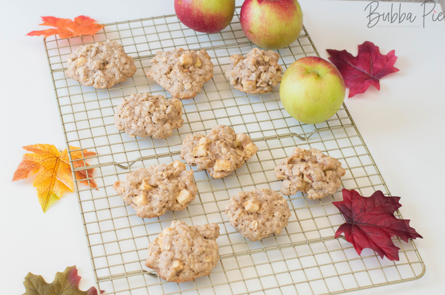 Apple Oatmeal Cookies Sitting on a cooling rack surrounded by Fall decorations