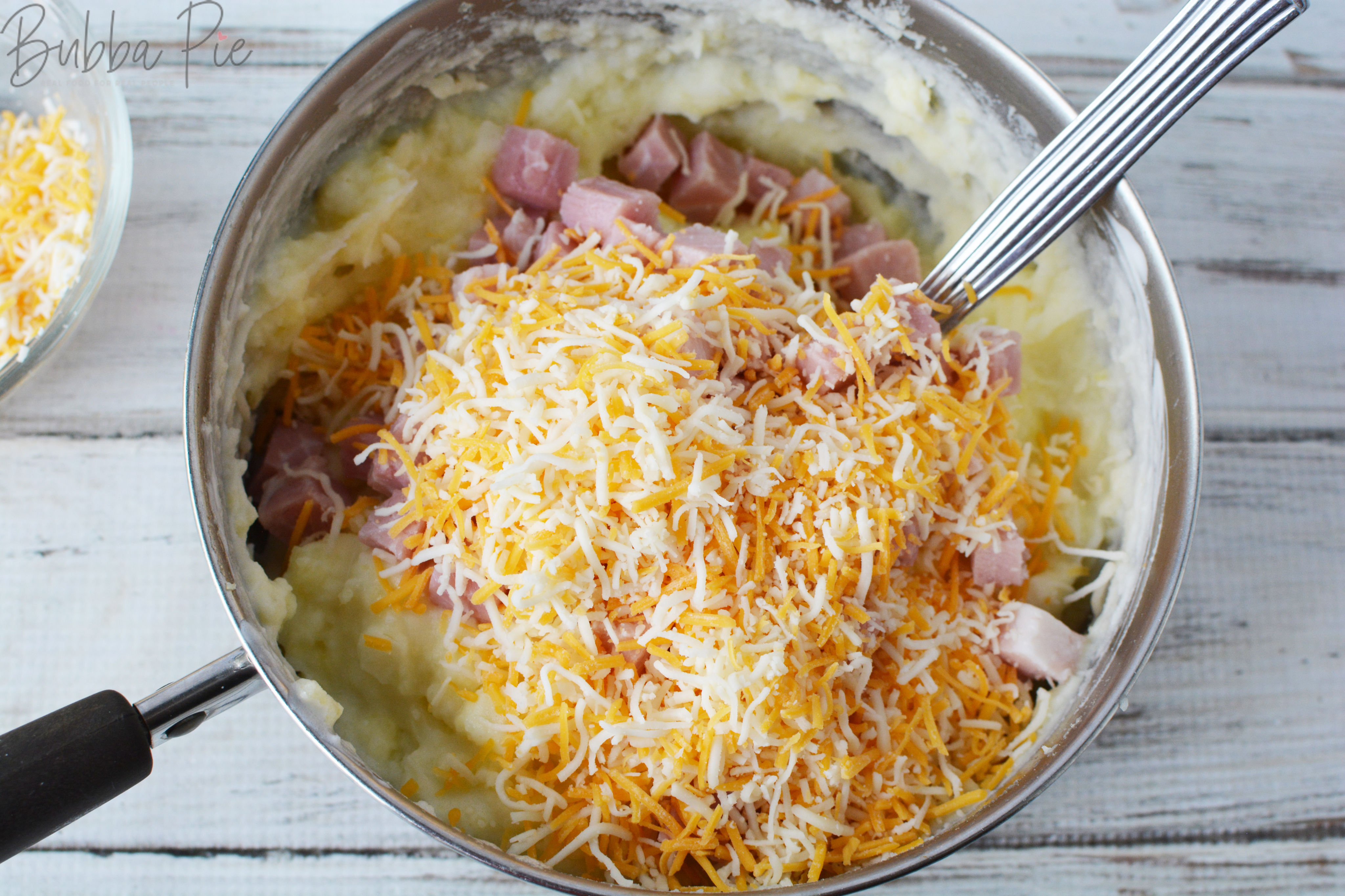 twice baked mashed potato casserole ingredients include colby jack cheese, ham and onions