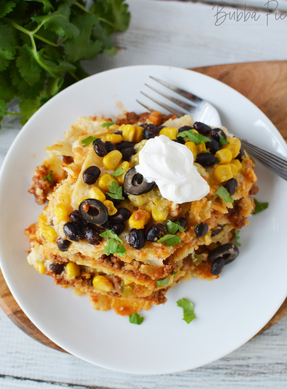 Crockpot Taco Casserole sitting on a table ready to serve for dinner
