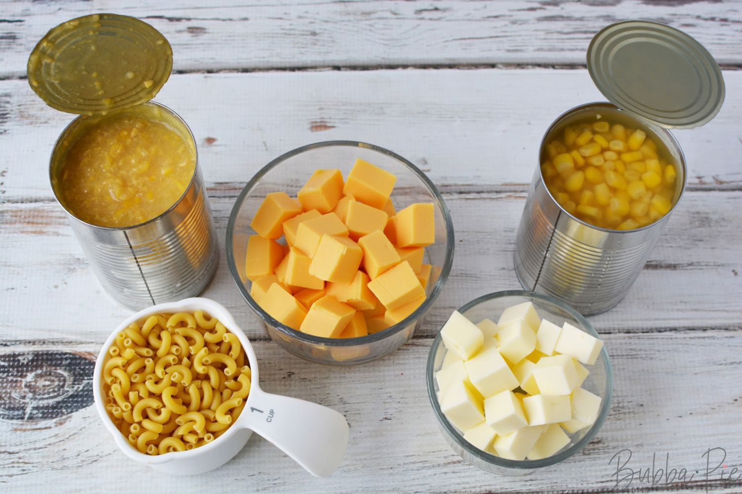 Macaroni Corn Casserole Ingredients creamed corn, velveeta cheese and elbow macaroni