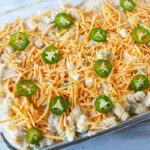 Top casserole with jalapenos and cheese.
