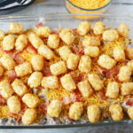 adding more tater tots on top