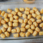 pouring tater tots in casserole pan.