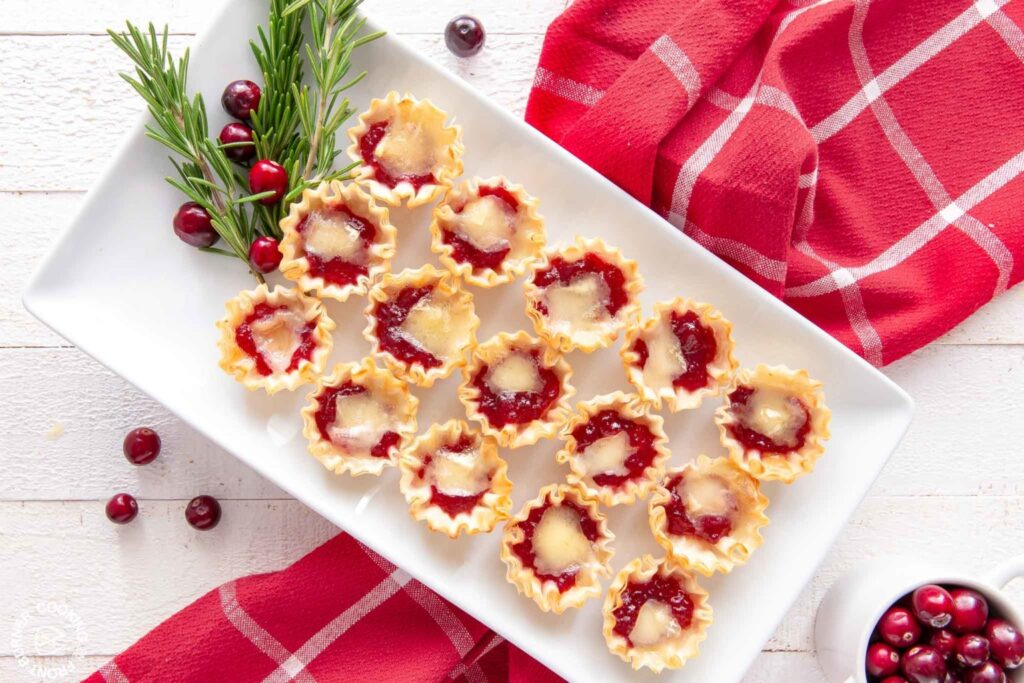 Cranberry Orange Brie Tarts being served on a white tray