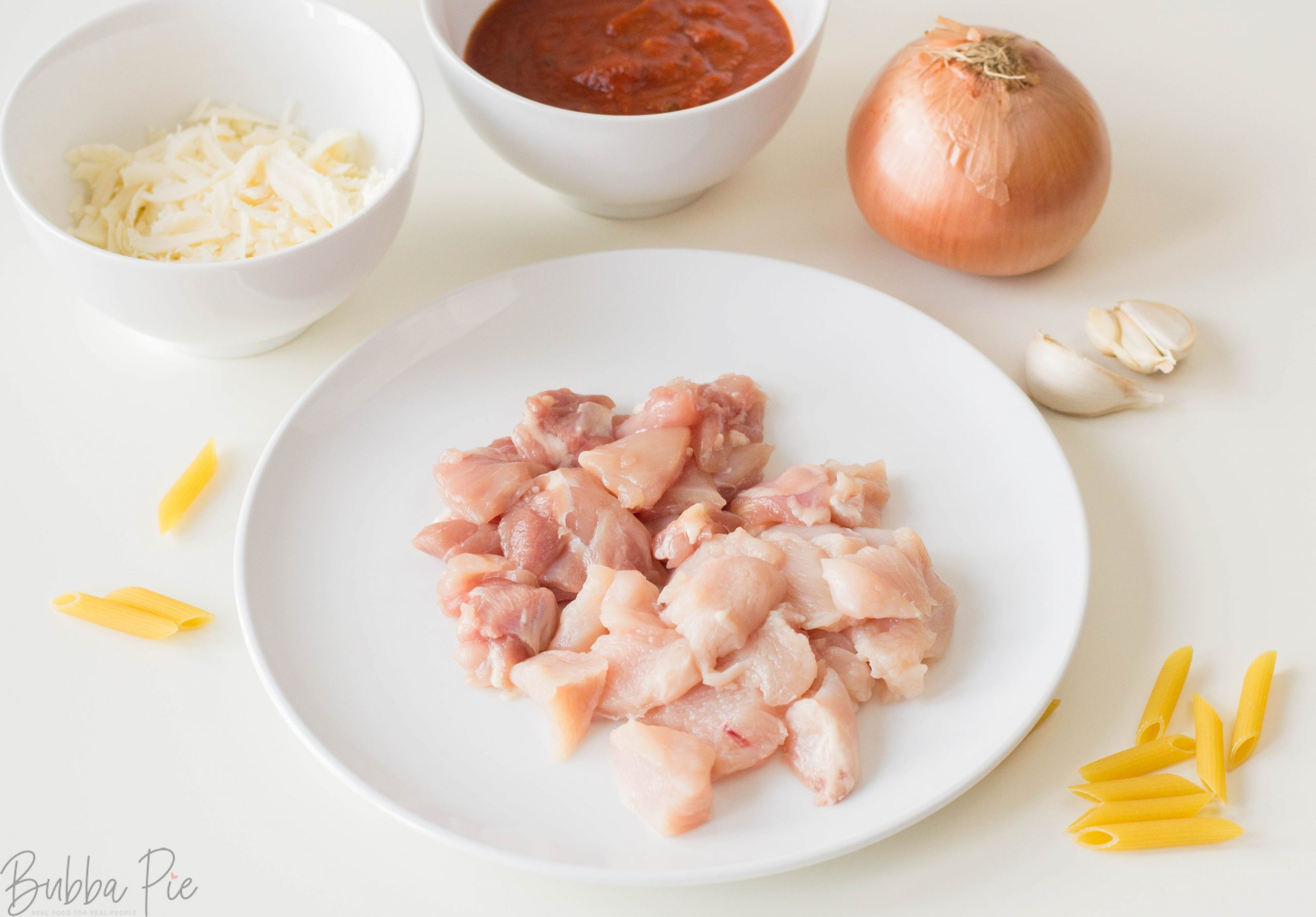 Instant Pot Chicken And Cheese Pasta ingredients include chicken, garlic, onion, butter and tomato sauce