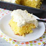 Easy Pineapple Sunshine Cake is made with whipped cream, yellow cake mix and pineapples