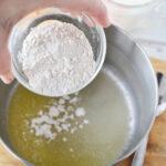 Stir in flour, salt and pepper.