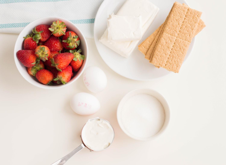 Mini Strawberry Cheesecake Ingredients include cream cheese, strawberries, sugar and graham crackers