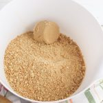 To make the crust, combine the graham cracker crumbs and brown sugar.