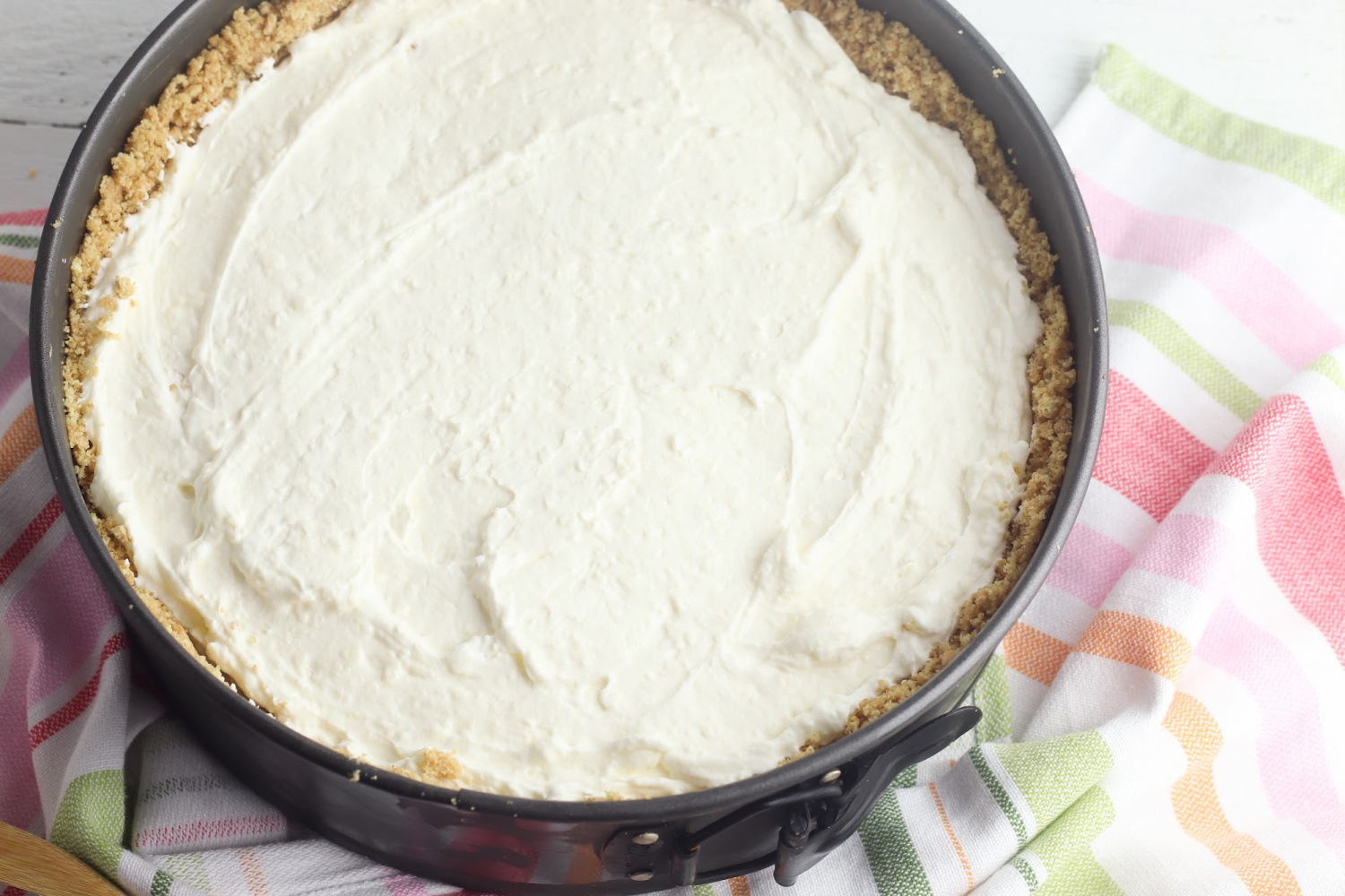 Blueberry Cheesecake Instructions involve combining heavy cream, cream cheese and sugar onto a graham cracker crust.