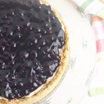 Before serving, spread the blueberry pie filling over the top of the cheesecake.