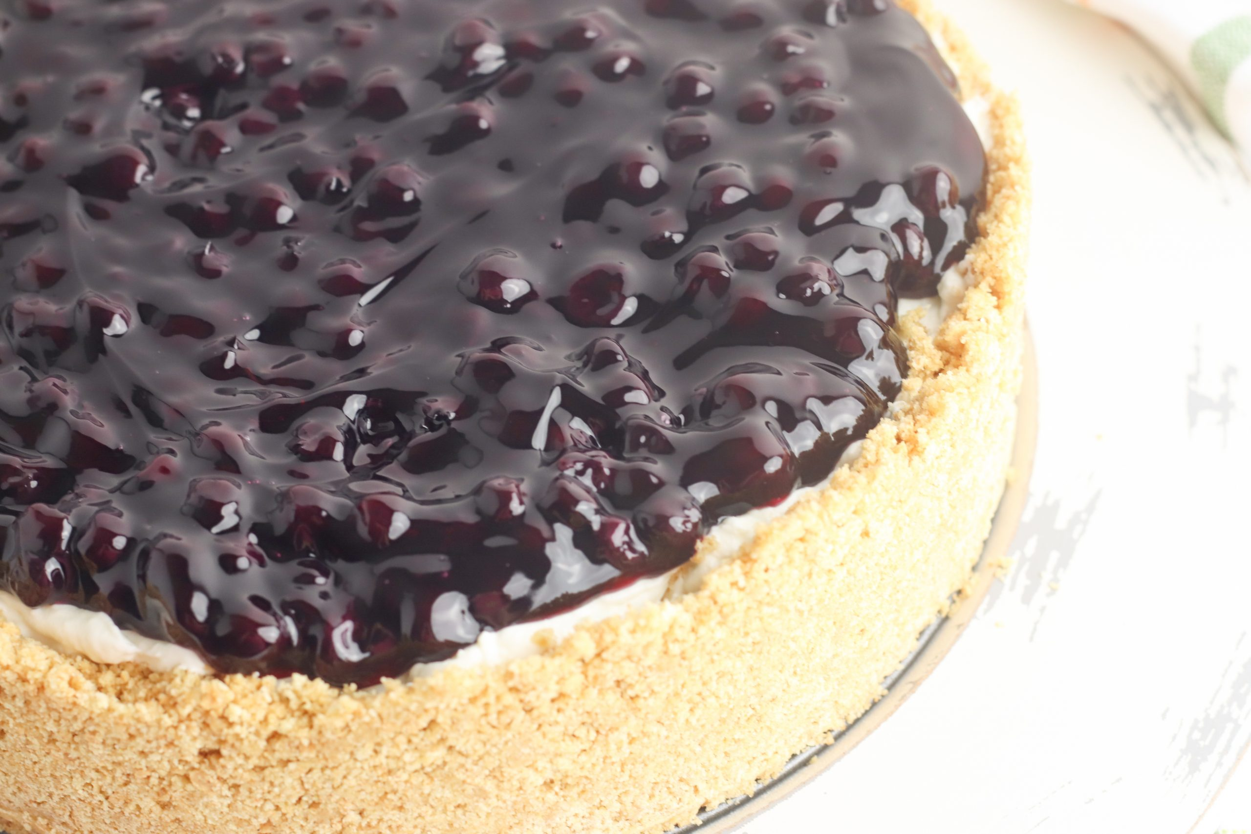 Blueberry no bake Cheesecake Recipe sitting on a platter waiting to be served for dessert.
