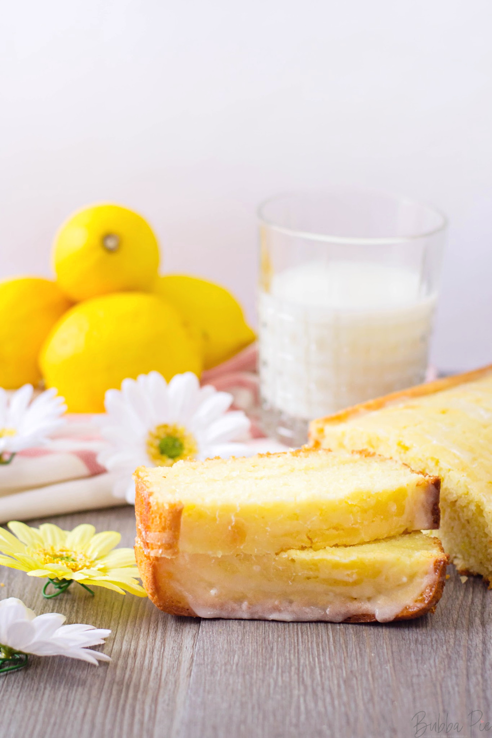 Lemon Loaf Cake served as dessert with a glass of milk.