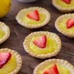 Mini Strawberry Lemon Tarts Recipe has fresh lemon filling with fresh strawberries on top.