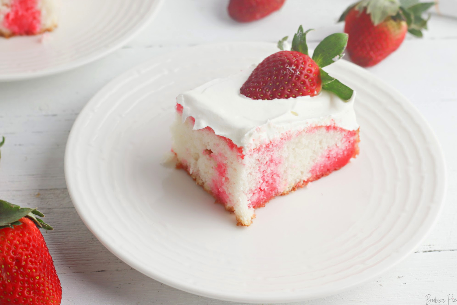 Strawberry Poke Cake made with box cake mix and jell-o.