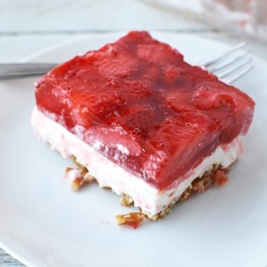 Strawberry Pretzel Salad sitting on a plate ready to be served for dessert.