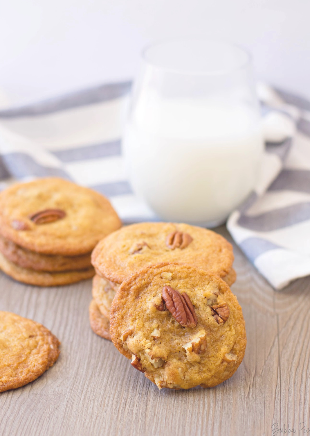 Butter Pecan Cookies served with a glass of milk.