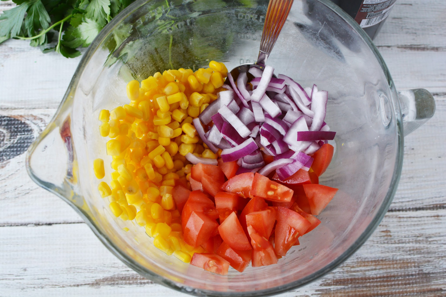Corn and Tomato Salad instructions include red onion, parsley and olive oil.