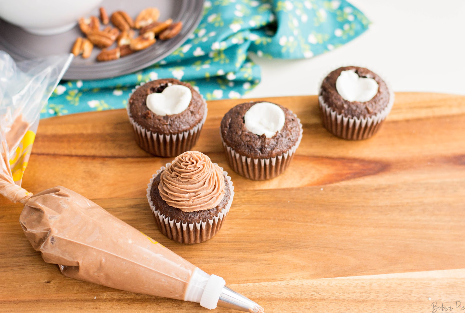 Rocky Road Cupcakes have you put a large marshmallow into the center of your cupcakes