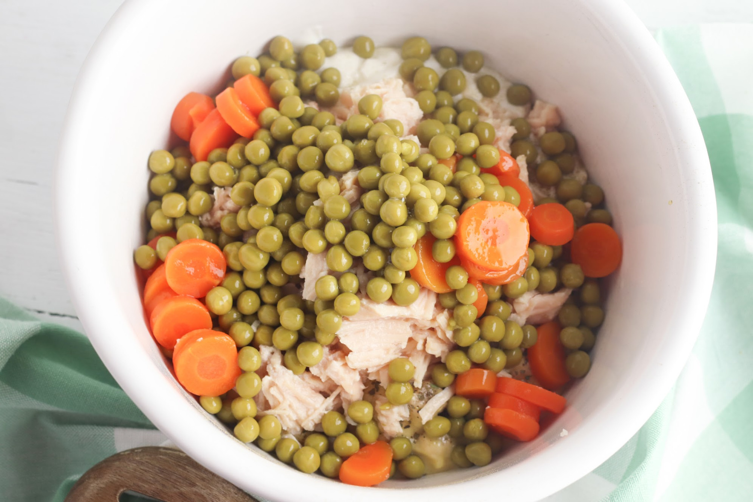 Ritz Chicken Casserole Directions include mixing in the peas and carrots with the other ingredients.