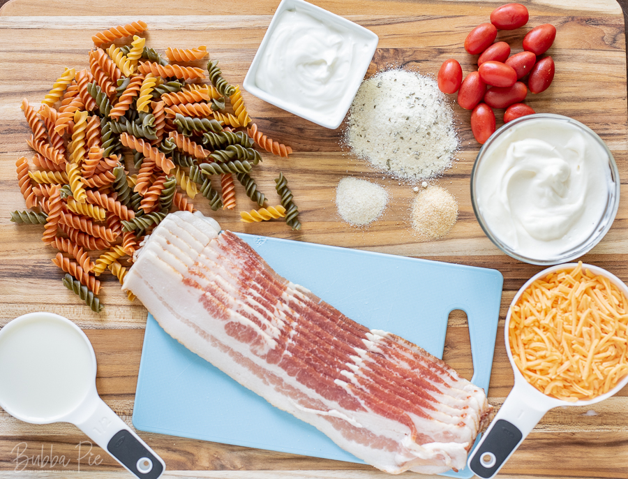 Bacon Ranch Pasta Salad Ingredients include cheese, sour cream, mayonnaise, garlic and onion salt.