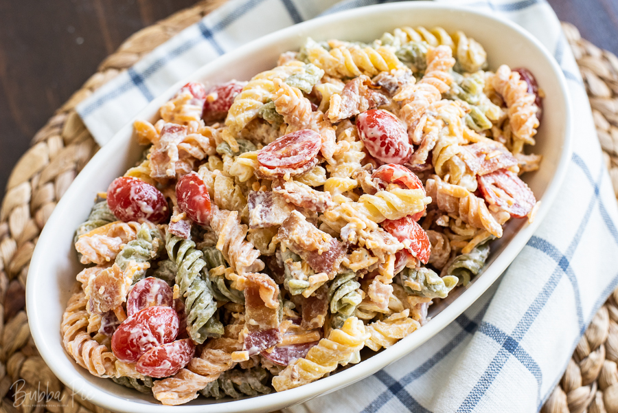 Bacon Ranch Pasta Salad has sour cream, mayonnaise, cheese and tomatoes.