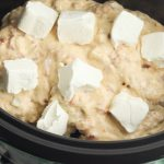 Put chicken, soup mixture and cubed cream cheese in crock pot.