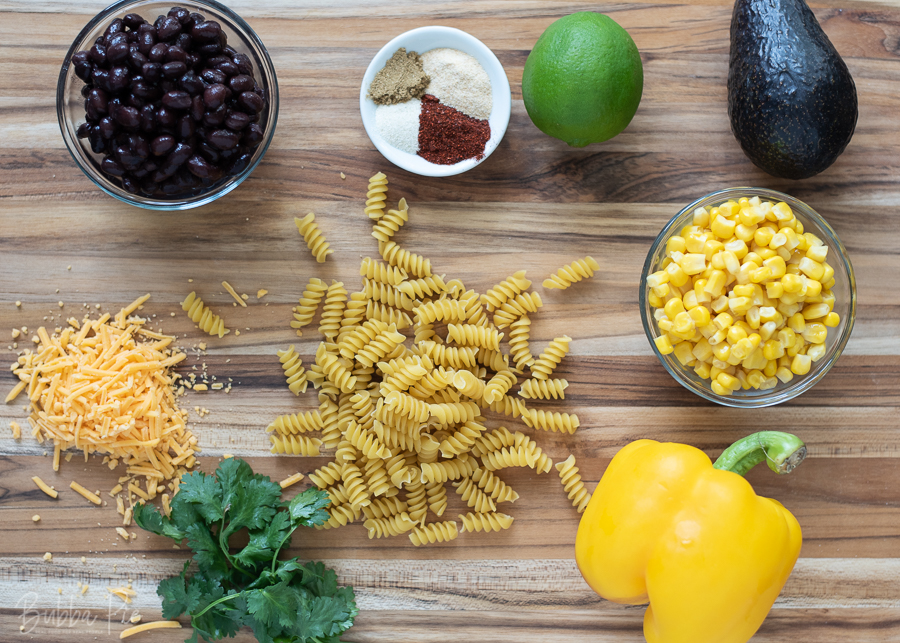 Southwest Pasta Salad Ingredients include corn, beans, avocado, cilantro and lime.