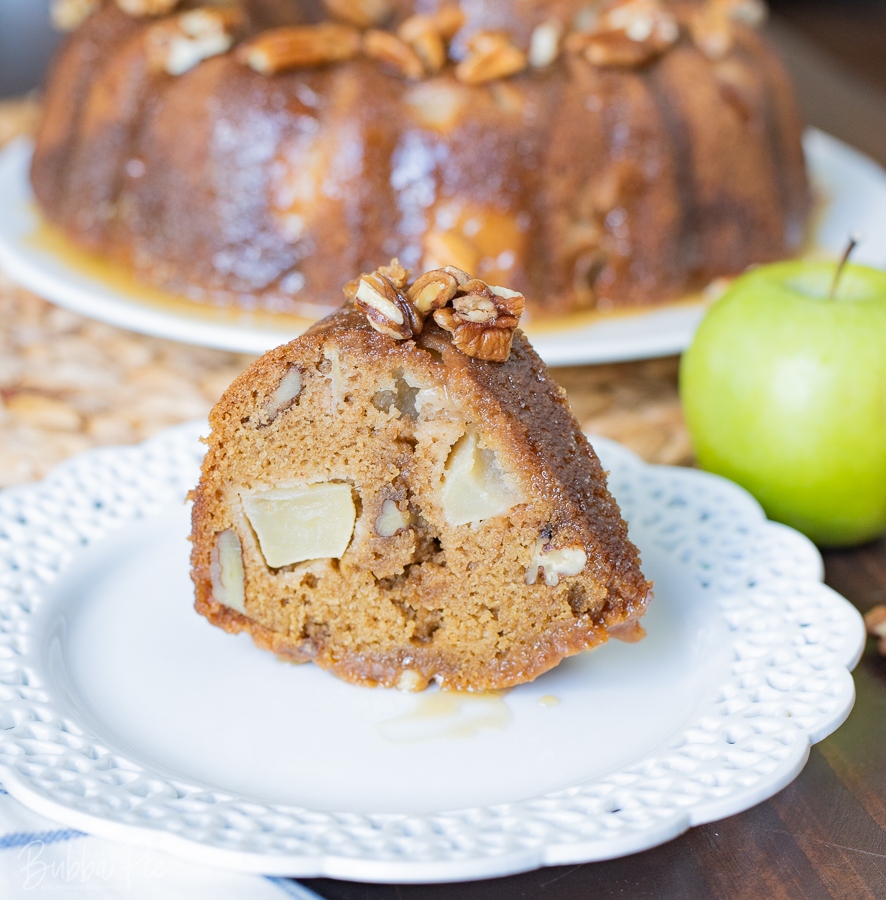 A slice of Apple Dapple Bundt Cake being served for the Holidays.