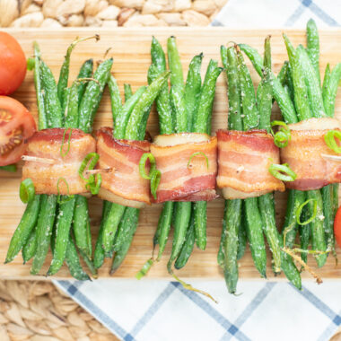 Bacon Wrapped Green Bean Bundles with a maple glaze being served for Thanksgiving.
