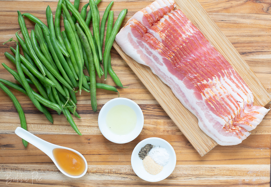 Bacon Wrapped Green Beans Ingredients include garlic powder, salt and maple syrup.