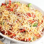 sprinkle cheese on top of chicken fajita casserole.