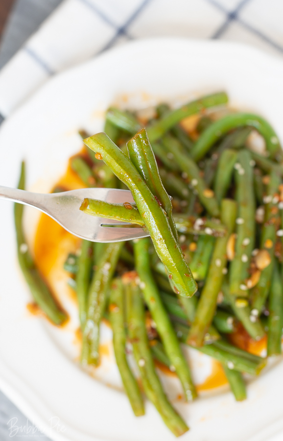 Garlic Chili Green Beans being served as a side dish for dinner.
