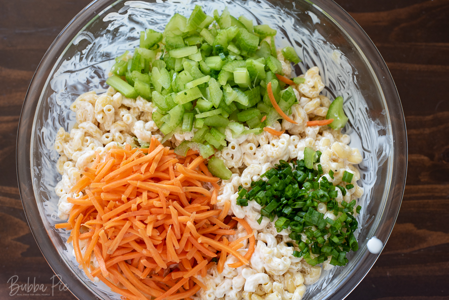 Hawaiian Pasta Salad Instructions include adding the carrots, celery and green onions after you add the hawaiian dressing.