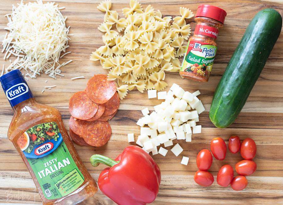 Salad Supreme Pasta Salad Ingredients include tomatoes, cucumbers and red peppers.