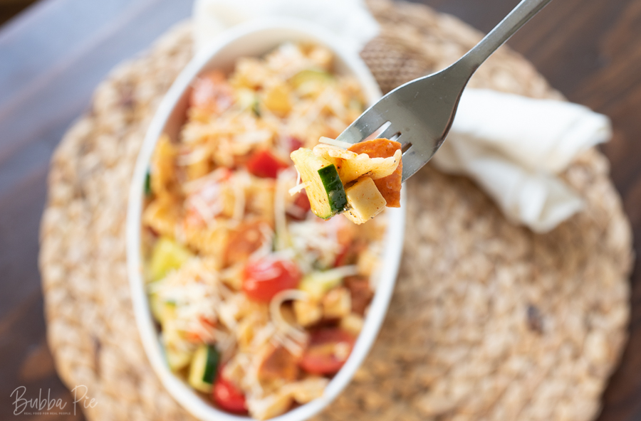 Salad Supreme Pasta Salad Recipe being served as a side dish at a cookout.