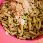 mix together green beans, brown sugar, melted butter, soy sauce and minced garlic for arkansas green beans.
