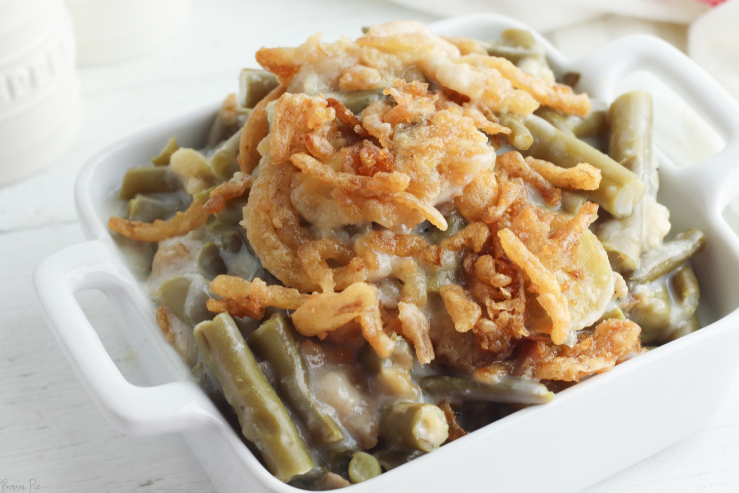 Crockpot Green Bean Casserole being served as a holiday side dish.