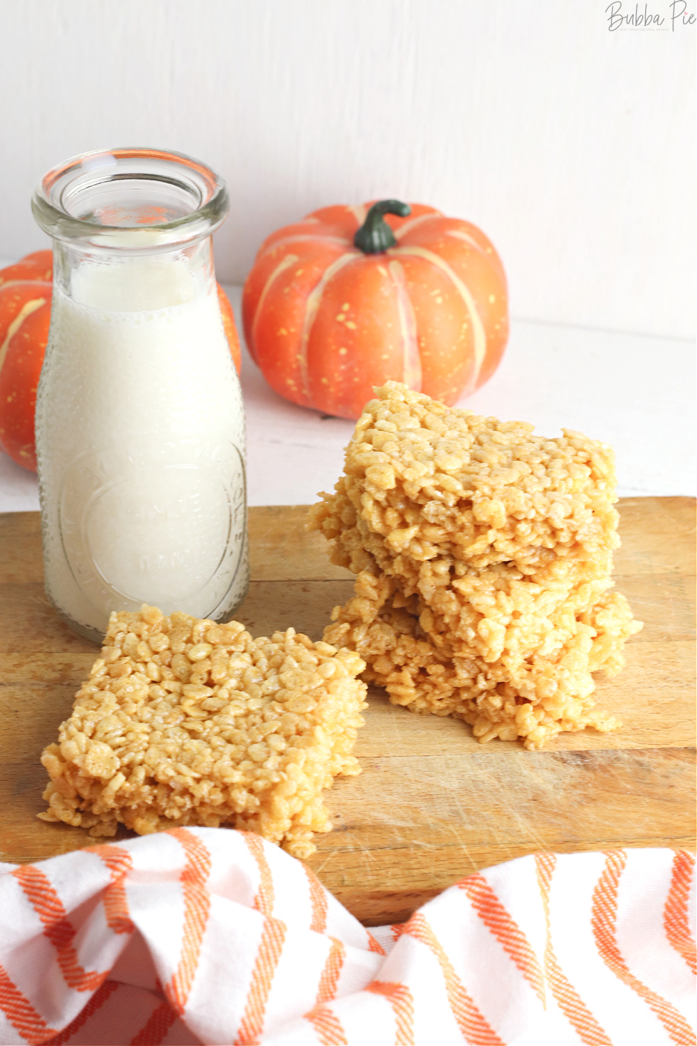 Pumpkin Flavored Rice Krispie Treats on a table with Fall Decorations