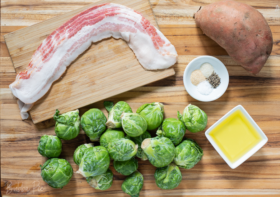 Roasted Brussels Sprouts with Sweet Potatoes Ingredients include olive oil, bacon and seasonings.