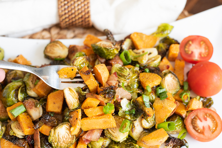 Roasted Brussels Sprouts with Sweet Potatoes being served for dinner.