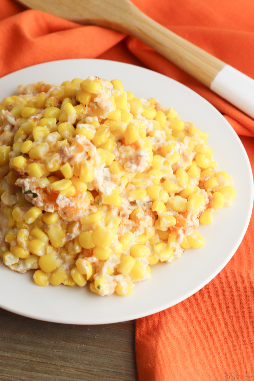 Cream Cheese Corn Casserole with Bacon being served as a side dish.